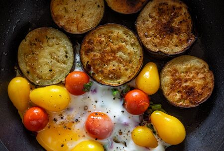 Top view on frying pan with vegetables and egg Stock Photo