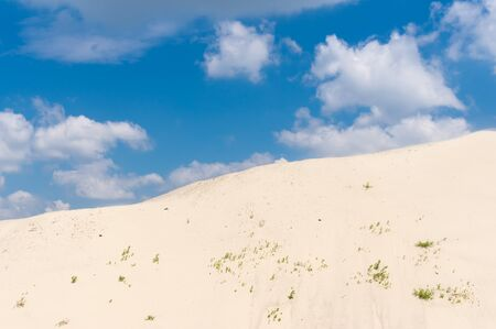 Summer landscape with hill of Dnipro river sand against blue cloudy sky Stock Photo