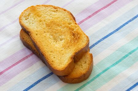 Two simple toasts lying on a table-cloth 版權商用圖片