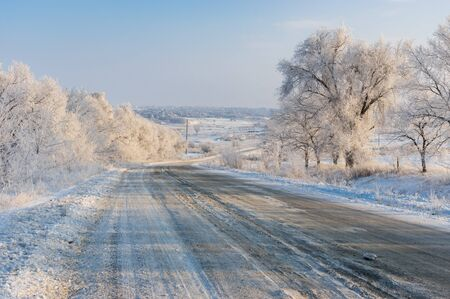 Winter landscape with country slippery road near Solone village  in central Ukraine