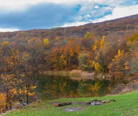 Autumnal colorful landscape with forest lakeside on Crimean mountains