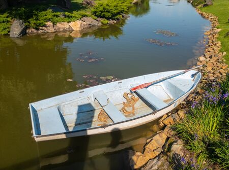 Small boat waiting for tourists in small artificial canal of Dnipro river