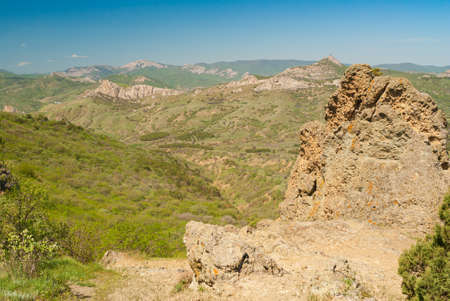 Landcape with view from Kara-dag volcanic mountain range to Meganom cape on eastern Crimean peninsula