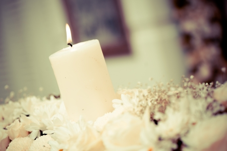 White romantic candle light in the midst of floral decorations