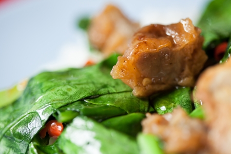 chinese spinach: Stir fried Chinese spinach with crispy pork Stock Photo