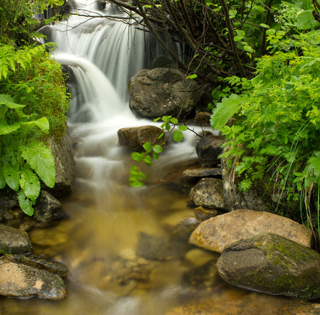 Waterfall movement on the stone background Stock Photo