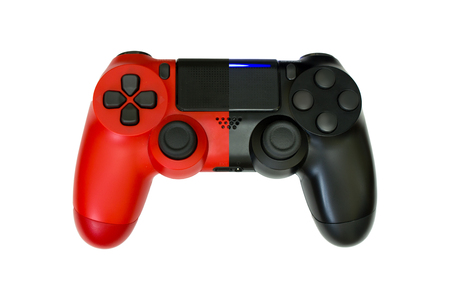 Gaming concept. Red and black joysticks on yellow background.