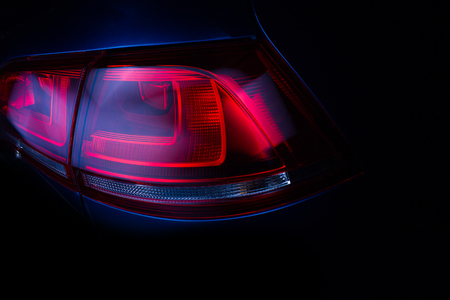 The rear lights of the car. Developed modern car's rear brake light. Close-up.