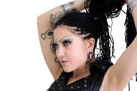 durchbohrt: junge stilvolle Frau mit Dreadlocks und Tunnel Lizenzfreie Bilder