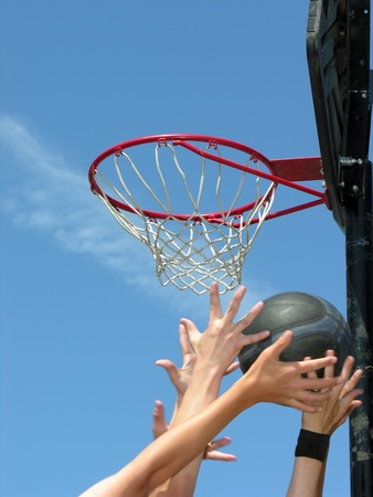 street basketball moment, focused on basketball hoop