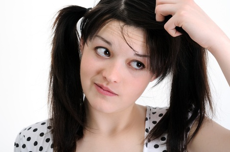 worried young woman touch hair photo