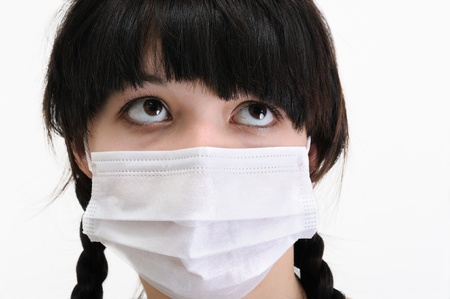 swine flu: close-up of young woman in protective medical mask