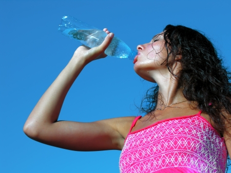 sweaty:           Thirst  Young woman drinking cold water in hot day