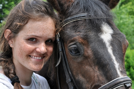 freckled: happy  teenage girl and horse in sunny day