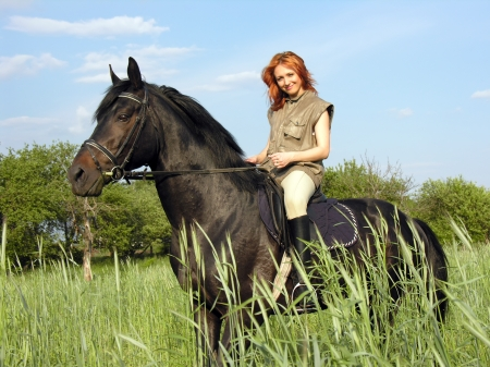 young woman riding in summer day