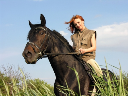 horseback: young woman riding in summer day