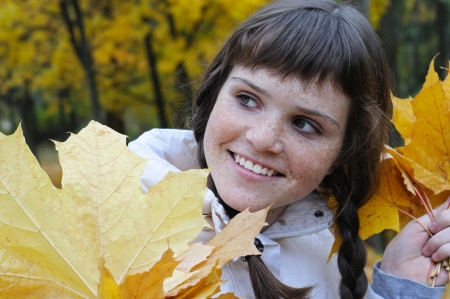 freckled: close-up portrait of freckled teenage girl in the autumn park  2