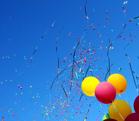 noisemaker:  multicolored balloons and confetti in the city festival  10