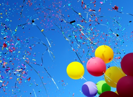 multicolored balloons and confetti in the city festival  11 Stock Photo