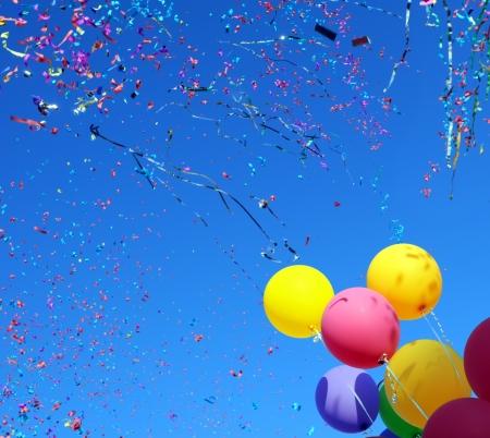 multicolored balloons and confetti in the city festival 8 Stock Photo