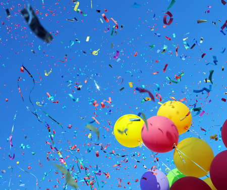 celebration party:  multicolored balloons and confetti in the city festival