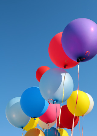 multicolored balloons in the city festival, vertical composition
