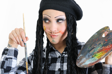 dreads: young stylish woman with dreads in painter style holding brush and palette
