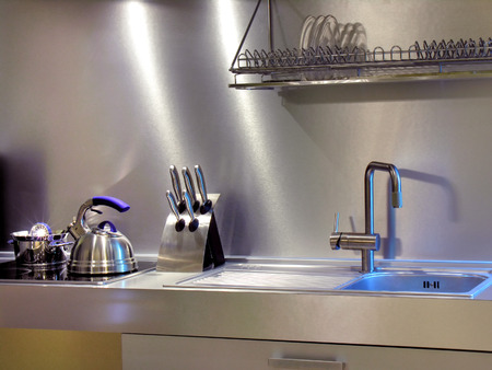 home lighting: close-up of the modern kitchen equipment in the home interior in mixed lighting