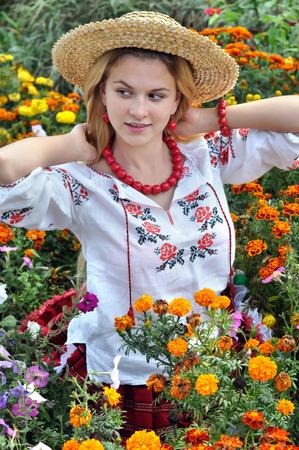 cute teen girl: украинская девушка в традиционной одежде среди цветов Фото со стока