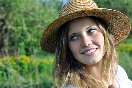blond girl: portrait of a teenage   girl in the meadow in sunny day Stock Photo