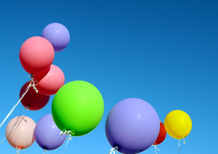 multicolored: multicolored balloons in the city festival on blue sky background