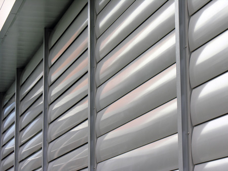louvered: Metallic  window shutter at the  office building, innovation technique