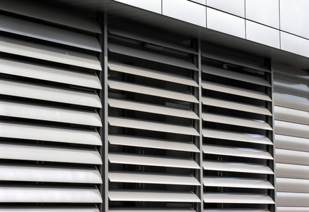 louvered: metallic   window shutter at the  office building, innovation technique Stock Photo