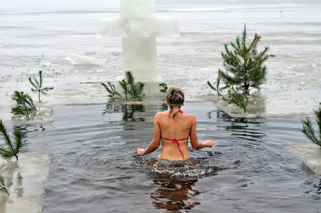 holiday tradition: CHERKASY, UKRAINE - JANUARY 19: Unidentified woman swimming in ice cold water during Epiphany (Holy Baptism) in the Orthodox tradition, January 19 , 2013 in Cherkasy, Ukraine