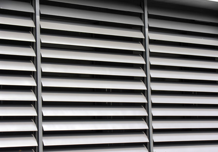 louvered: opened metallic   window shutter at the  office building, innovation technique