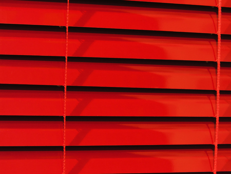 red and black: close-up of red horizontal blinds