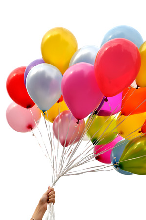 woman's hand holding bunch of multicolored balloons in the city festival , vertical composition,isolated on white background Standard-Bild