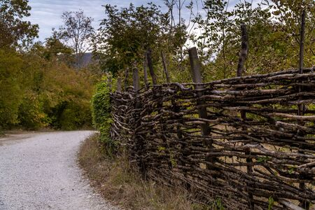Picturesque wicker village fence in the valley of the Zhane river near Gelendzhik. Zdjęcie Seryjne