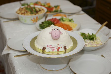 regards: beautiful delicious cake with symbols, sheep, and Santa Claus with regards Stock Photo