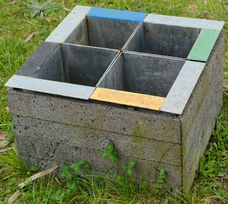 compartments: Trash can with four colored compartments Stock Photo