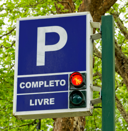 Traffic signs for parking and paid parking zones with traffic light photo