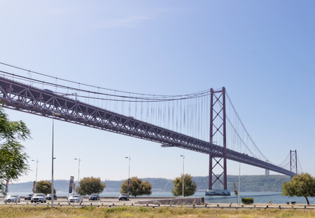 Lisbon, Portugal - May 15: 25th of April bridge in Lisbon on May 15, 2014. 25th of April bridge was originally named for Portugals right-wing dictator, Antonio de Oliveira Salazar. Portugal, Europe.