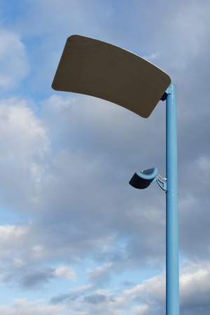 modern lamppost in front of a dramatic sky photo
