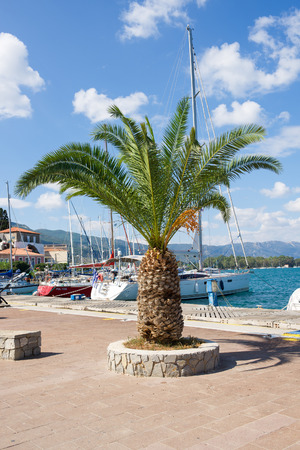 poros: POROS, GREECE - September 27, 2014: Marina of Poros, is a Greek island in southern part of Saronic Gulf, surface is 31 sq km  3,780 inhabitants. It is a popular weekend destination for Athenian travellers. Stock Photo