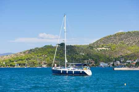 poros: POROS, GREECE - September 27, 2014: Marina of Poros, is a Greek island in southern part of Saronic Gulf, surface is 31 sq km  3,780 inhabitants. It is a popular weekend destination for Athenian travellers. Editorial