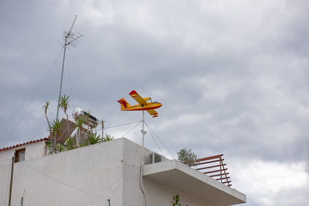garden settlement: The airplane-shaped weather vane at Aegina island in Greece