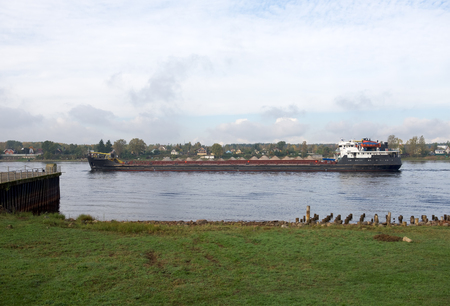 barge: Barge in Ladoga channel. View out fortress Shlisselburg in surroundings of Saint-Petersburg.