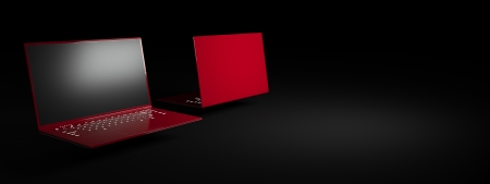 Red laptop on a black background  Two glossy, trendy ultrabook  Advertising image  Stock Photo - 18827478