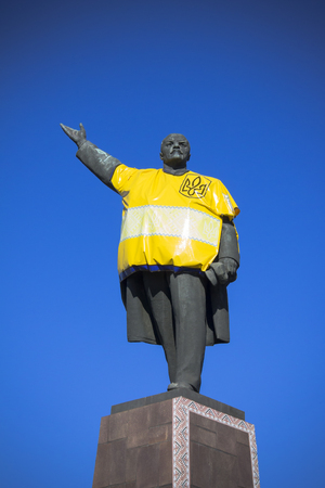 opponents: monument to Vladimir Lenin on which laughing opponents of communism