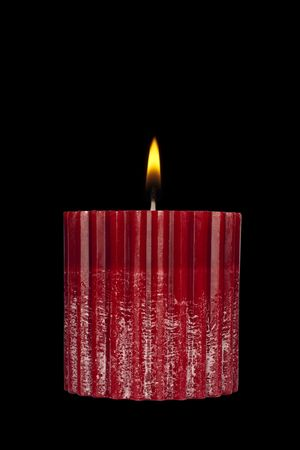calming: Red candle isolated over black Stock Photo
